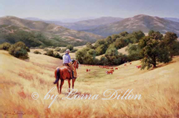 Cowboy on horse viewing rolling hills, cattle, mountains and Salinas valley beyond